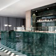 Photo of Maison du Danemark House of Denmark in Paris. Green stone bar top reflecting marble trends.
